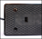 The underside of the M-Audio SP2 sustain pedal, showing the polarity switch.