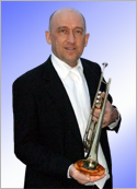 A photgraph of Keith Stead holding his trumpet.