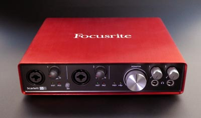 looking down on the Scarlett 6i6, showing the front panel and the red casing with the Focusrite logo printed on top.
