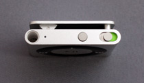 A view of the iPod Shuffle showing the on/off switch and VoiceOver button.